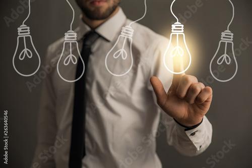 Obraz na płótnie man touching in light bulb