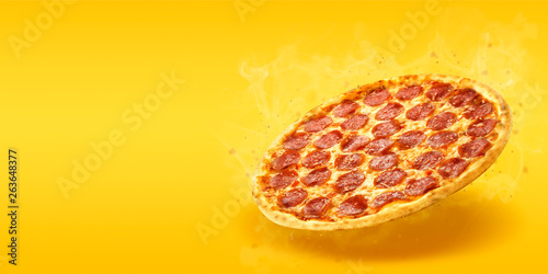 Photo sur Aluminium Pizzeria Creative layout of hot delicious pizza with smoke in flying on summer orange background. Pizza pepperoni design mockup flyer or poster for promotions and discounts with copy space. Fast Food concept