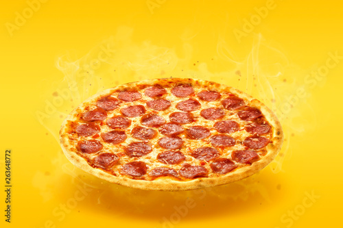 Cadres-photo bureau Pizzeria Creative layout of hot delicious pizza with smoke in flying on summer orange background. Pizza pepperoni design mockup flyer or poster for promotions and discounts. Fast Food concept