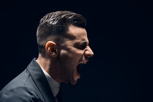 Profile View Of Angry Disappointment Man Shouting With Copy Space Isolated On Dark Background