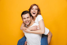 Portrait Of A Cheerful Young Couple Standing