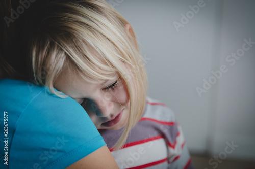 sad crying little girl hugging mother, parenting