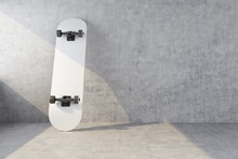 White Skateboard On Concrete W...