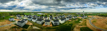 Aerial Panorama Of New Construction Luxury Residential Neighborhood Street With American Single Family Homes In Maryland USA Real Estate