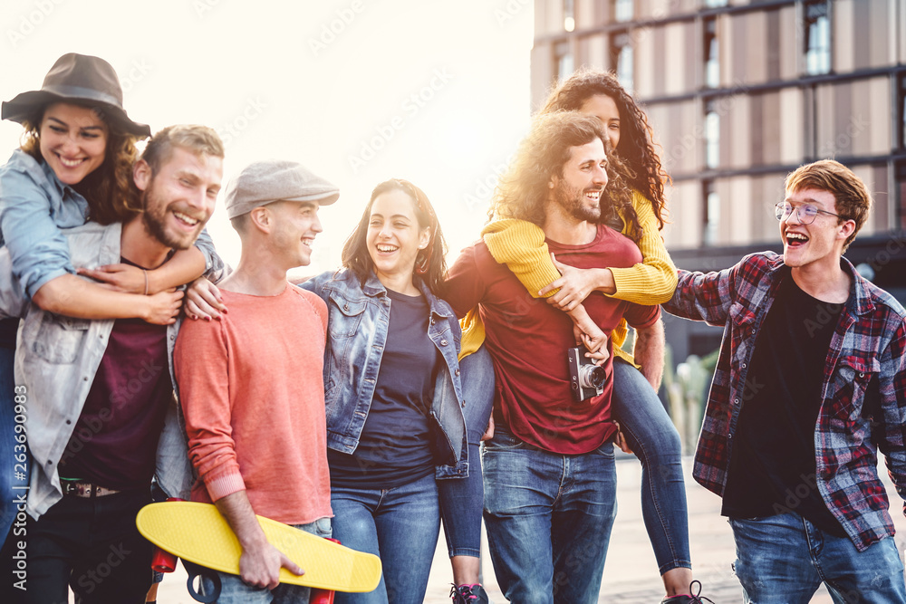 Fototapety, obrazy: Group of young people having fun in the city center - Happy friends piggybacking while laughing and walking together outdoor - Friendship, millennial generation, teenager and youth lifestyle concept