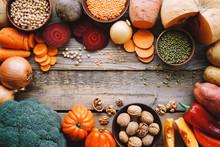 Seasonal Food On Wooden Table. Autumn Farm Vegetables And Legumes