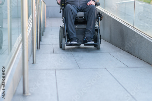 Man in a electric wheelchair using a ramp Poster Mural XXL