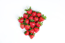 Ripe Local Produce Organic Strawberry. Heap Of Red Berries. Fresh Healthy Vegan Dietary Food For Spring Detox. Fruits Isolated On White Background, Top View. Clean Eating Concept.