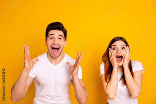 Close up photo amazing she her he him his couple hands arms raised air yell unbelievable luck lucky day cheerleader football match wear casual white t-shirts outfit isolated yellow background