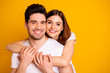 Leinwanddruck Bild - Close-up portrait of his he her she two nice cute lovely charming sweet tender attractive cheerful positive people cuddling isolated over vivid shine bright yellow background
