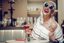 Cheerful Happy Aged Woman Having A Tattoo