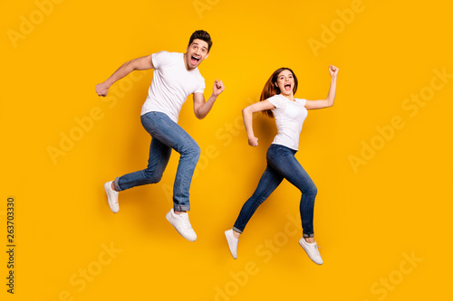 Fotografie, Obraz  Full length side profile body size photo funky she her he him his pair jumping h