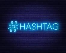Neon Hashtag Sign On Brick Wal...