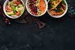 Collection of take away foil boxes with healthy food. Set of containers with daily meals. Top view. Free copy space.