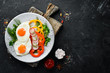 Breakfast. Fried eggs with vegetables. Top view. Free copy space.