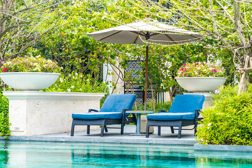 Fototapety, obrazy: Beautiful outdoor swimming pool in hotel and resort with chair and deck for leisure vacation