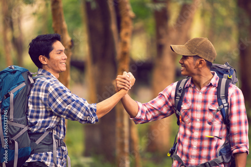Fotomural  Two best friends to join hands together to show unity and help each other