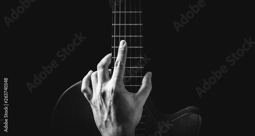 black and white male musician hand posing on guitar, isolated on black, music background  - 263740348