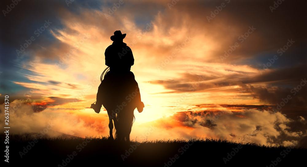 Fototapeta Cowboy on a horse at sunset