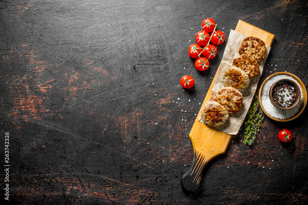 Fototapety, obrazy: Cutlets on paper with spices,thyme and tomatoes.