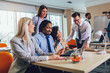 Group of young business people working together in creative office. Selective focus.