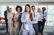 Group of happy business people and company staff in modern office, representig company.Selective focus.