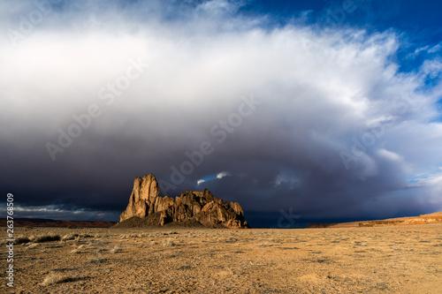 Obraz na plátně  Western landscape with blue sky and storm clouds