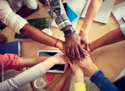 Fotografie, Obraz  education, school, teamwork and people concept - close up of international stude