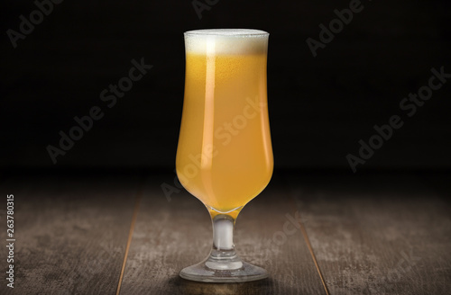 Fresh colorful unfiltered New England IPA in stemmed glassware on a wood table a Wallpaper Mural
