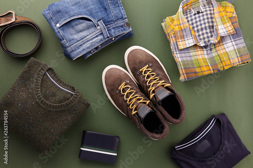 Fényképezés  Mens casual clothing outfits and accessories flat lay on olive green background,