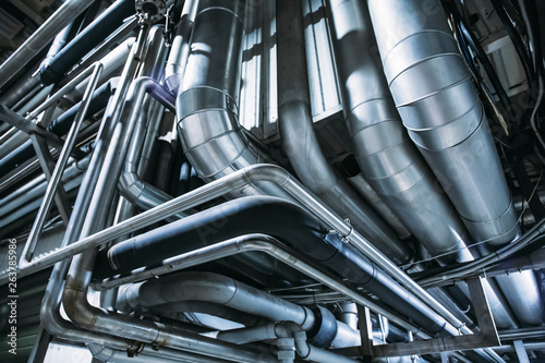 Obraz Industrial steel pipes or tubes of air ventilation system as abstract industry equipment background - fototapety do salonu