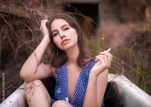 Poster Gypsy beautiful sexy young woman with a cigarette smokes