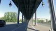 POV move under Pont De Bir-Hakeim with traffic on streets