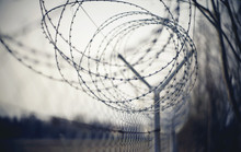 Abstract Blurred Background With Barbed Wire.