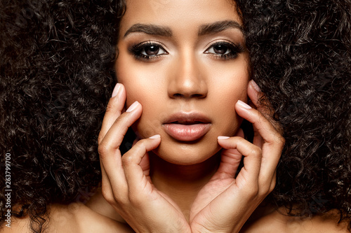 Beauty black skin woman African Ethnic female face. Young african american model with long afro hair. Lux model.