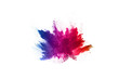 canvas print picture - abstract powder splatted background. Colorful powder explosion on white background.