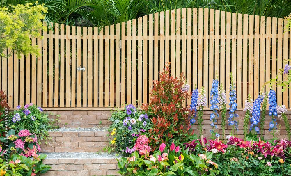 Fototapeta entrance and wooden fence of backyard flower garden