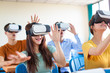 students having fun with new technology vr headset in classroom