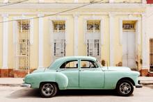 Vintage Green Car Parked On Street