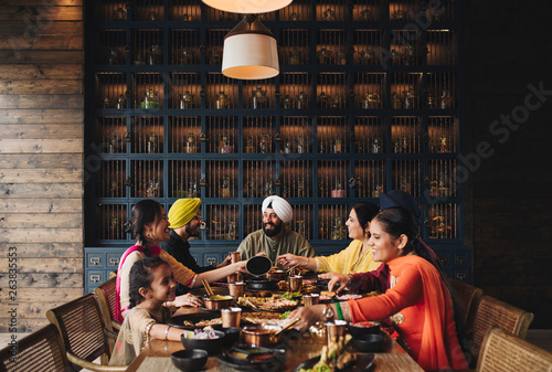 Family enjoying dinner time - 263835553