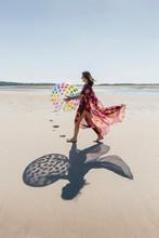 Beautiful Woman Playing On Beach With Beachball