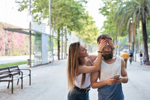 Girl Friend Giving Surprise To Friend In The City.