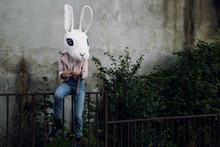 Woman With Bunny Mask On Fence