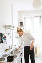 Female Entrepreneur Cleaning Her Kitchen