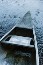 Canoe At Lake In Rainstorm