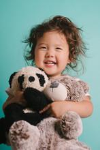 Little Kid Hugging Stuffed Ani...
