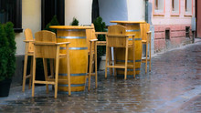 Empty Wooden Chairs And Tables...