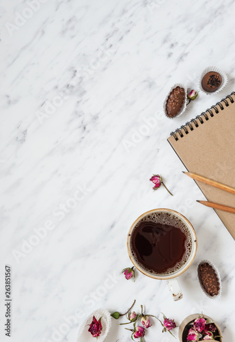Cup of black coffee and a notebook