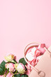 canvas print picture Pink roses flowers on a pink  background.