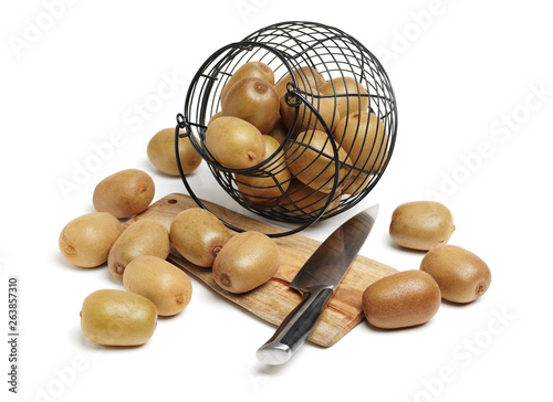 Whole and cut golden kiwifruit/ kiwi (Actinidia chinensis) on white background Canvas Print